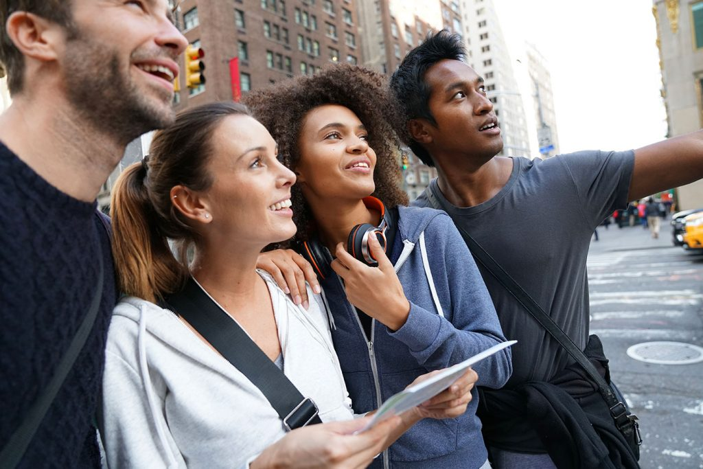 group of tourists looking up in a city on a walking tour